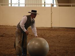 Chris explaining the benefits of the swiss ball, to clinic participants.